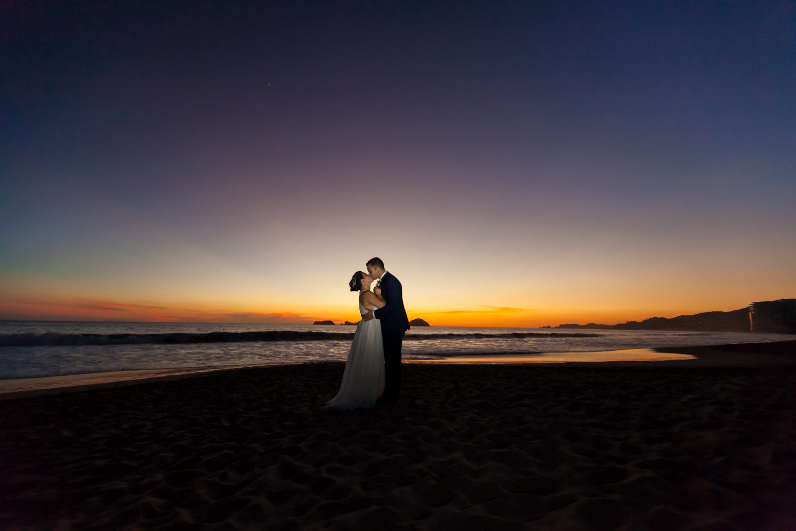 Sunset picture of bride and groom at their Sunscape Dorado Pacifico Ixtapa destination wedding