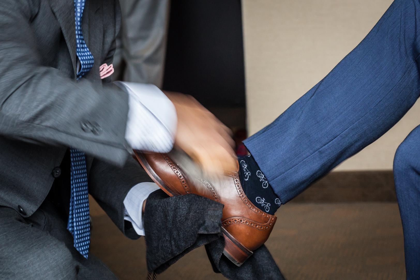 best man shining shoes
