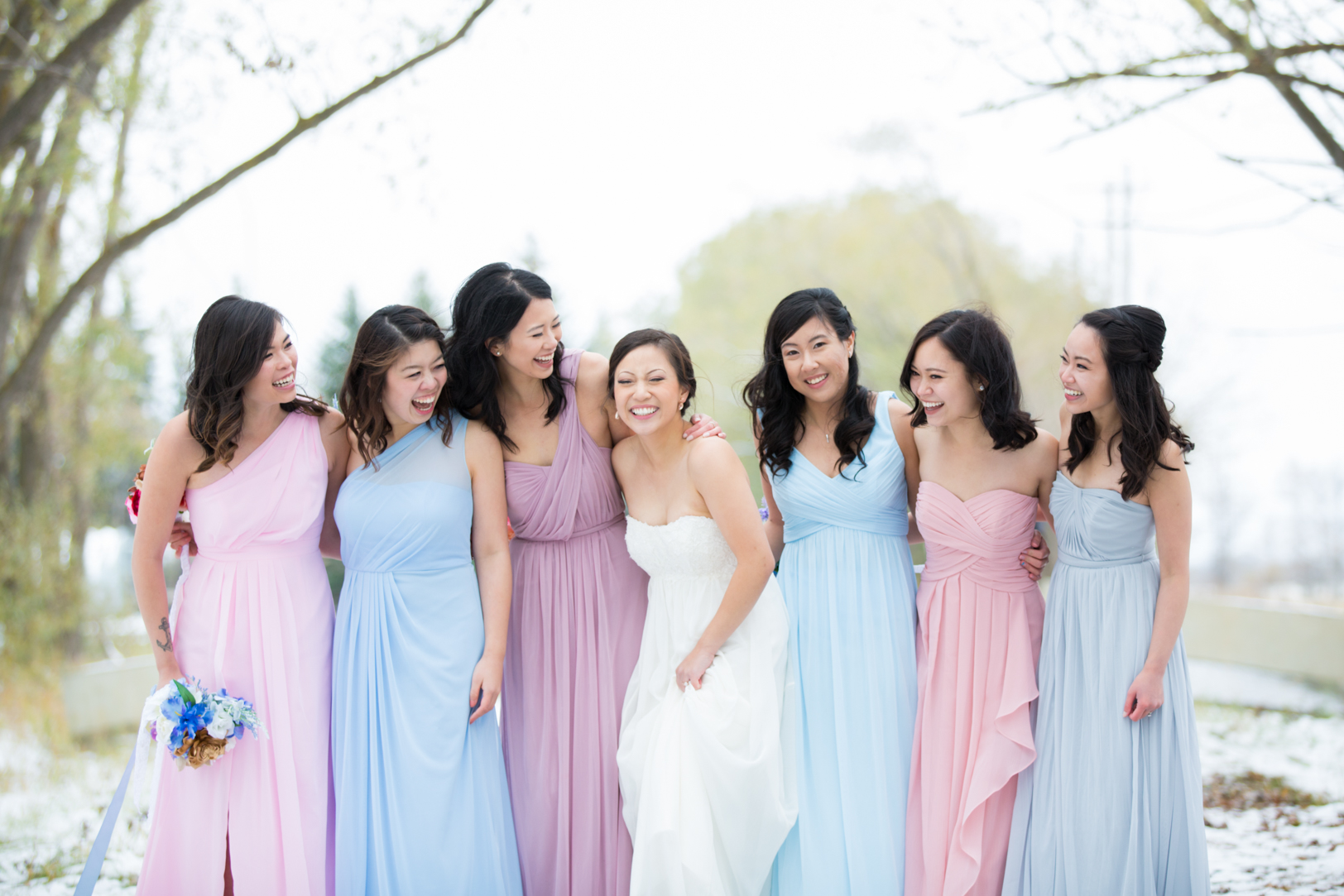 Bridesmaids laughing at an Edmonton Autumn Wedding