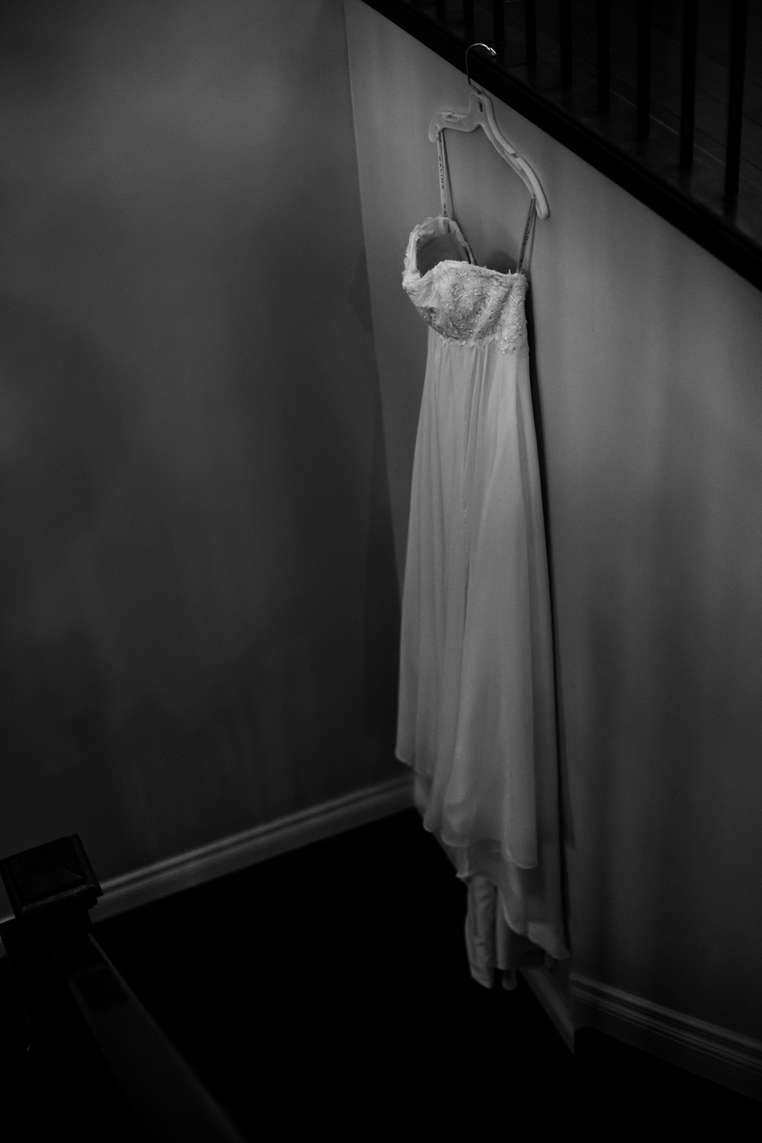 Photo of Wedding Dress Hanging Up