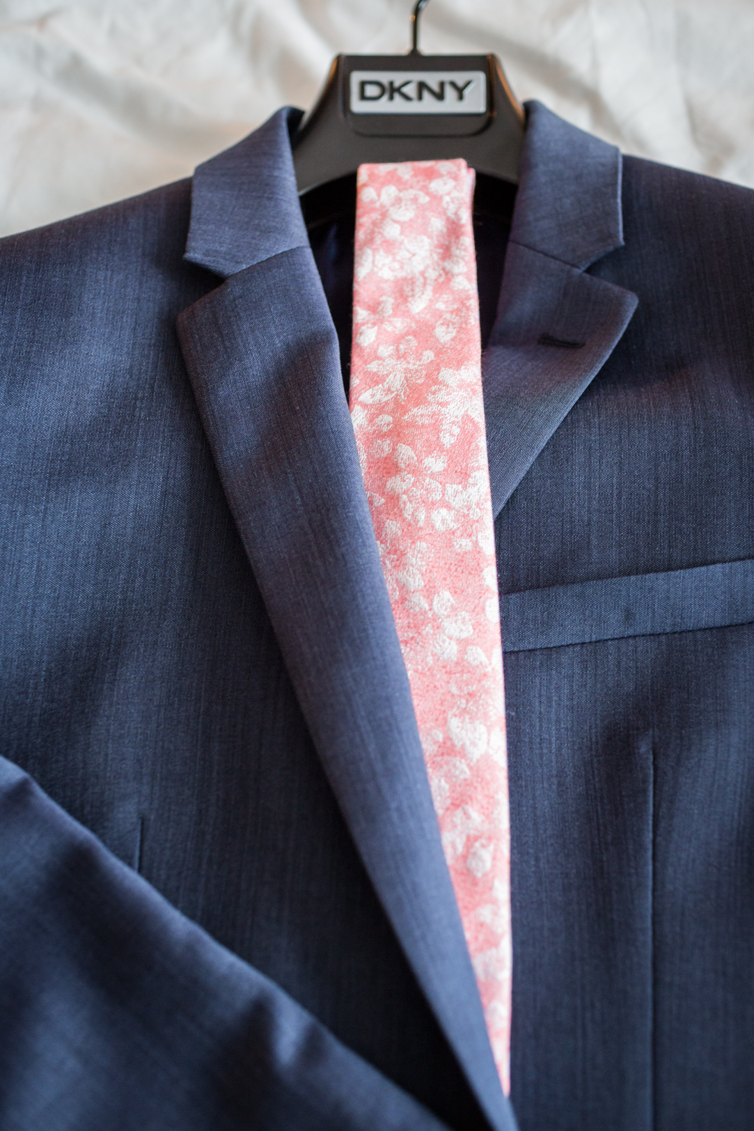 navy and pink wedding suit