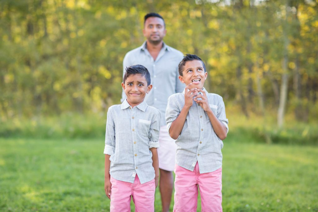 A picture of boys making faces during family photos