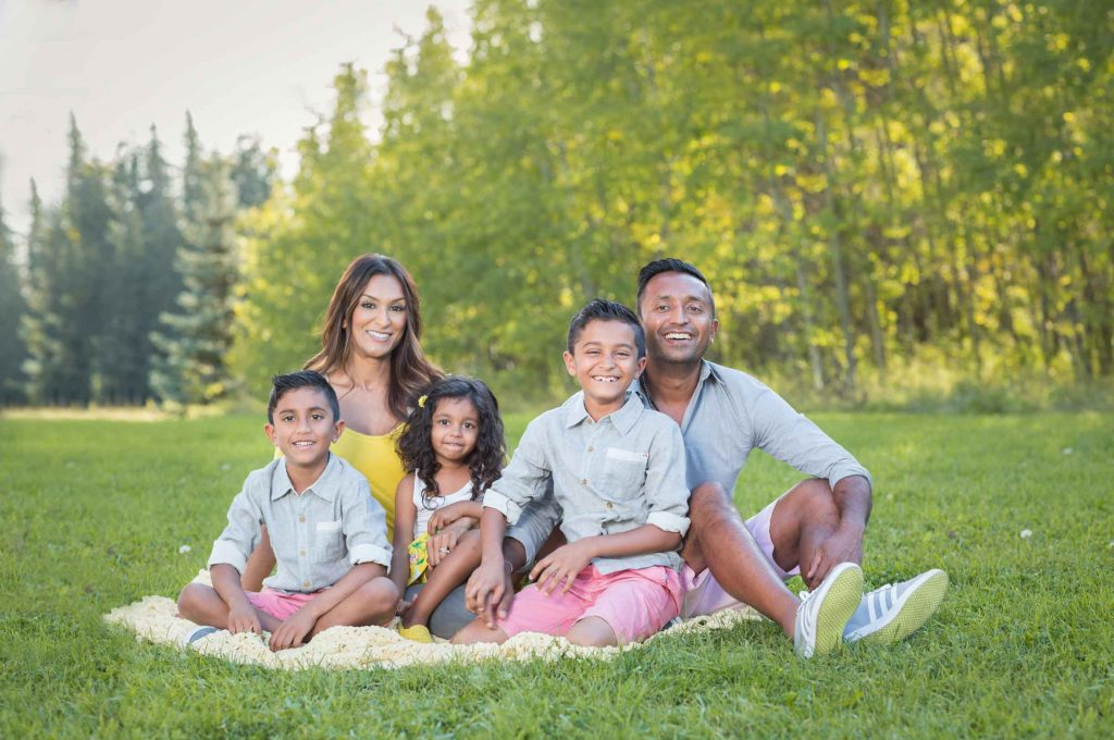 Family sitting on a blanket for family photos
