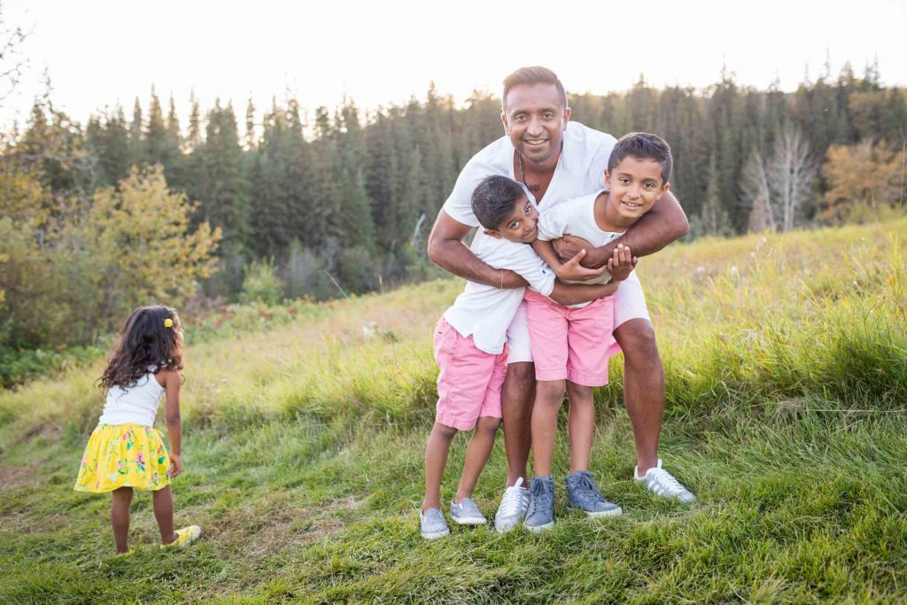 A picture of Dad playing with the kids during their photo session - Edmonton Family Photography