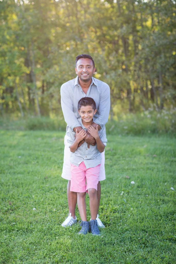 Father and son hugging during their Edmonton family photography session