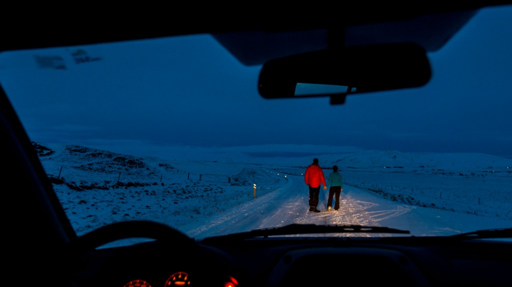 picture of couple at night while winter driving in iceland