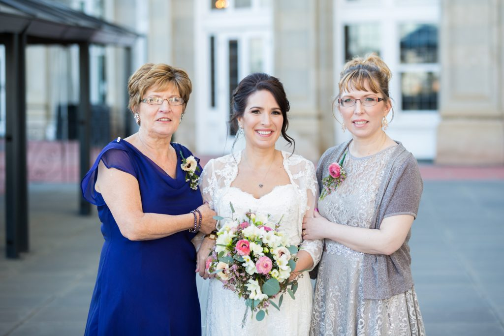 Bride with her sister and mother