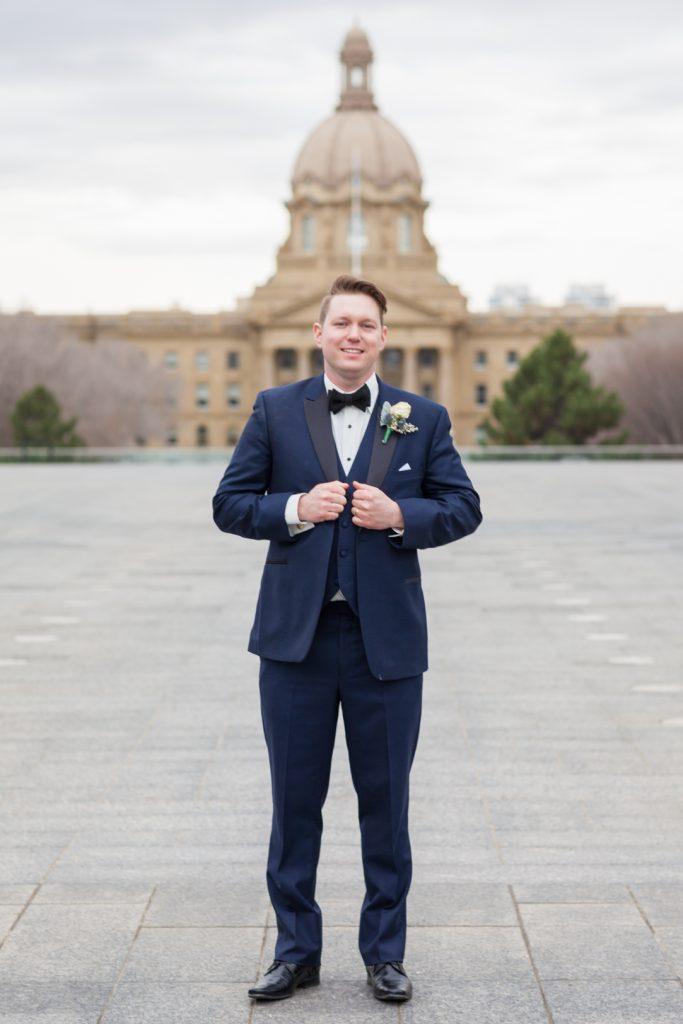 Groom portrait in front of Alberta Legislature