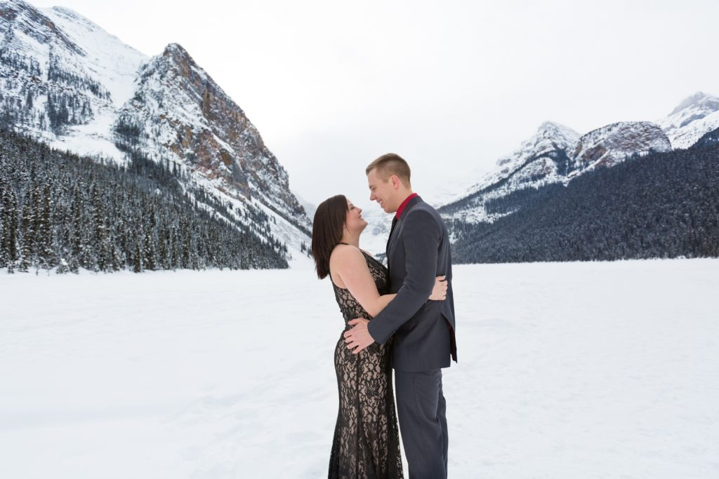 Mountain engagement photos at Lake Louise - Mountain Engagement Photography by Deep Blue Photography