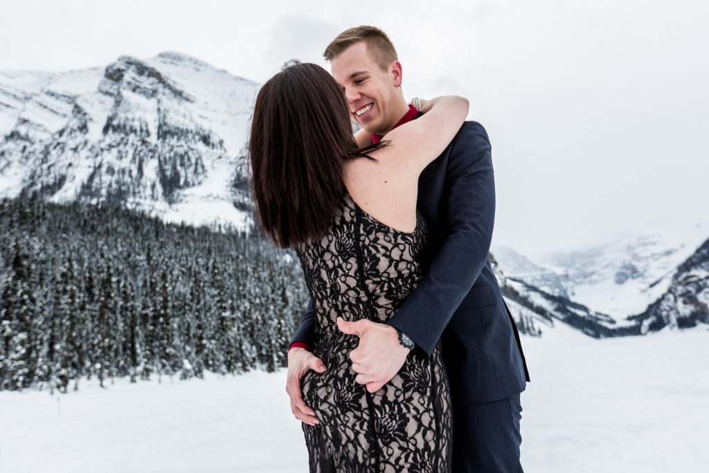 Couple holding each other close for winter engagement session - Mountain Engagement Photography by Deep Blue Photography