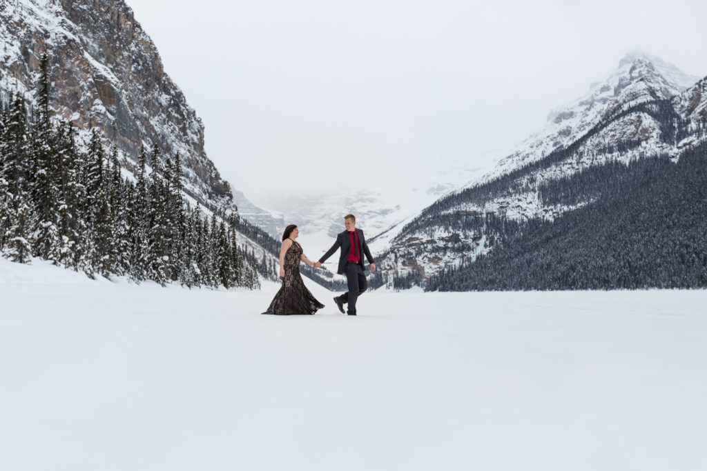 Couple walking and holding hands - Mountain Engagement Photography by Deep Blue Photography