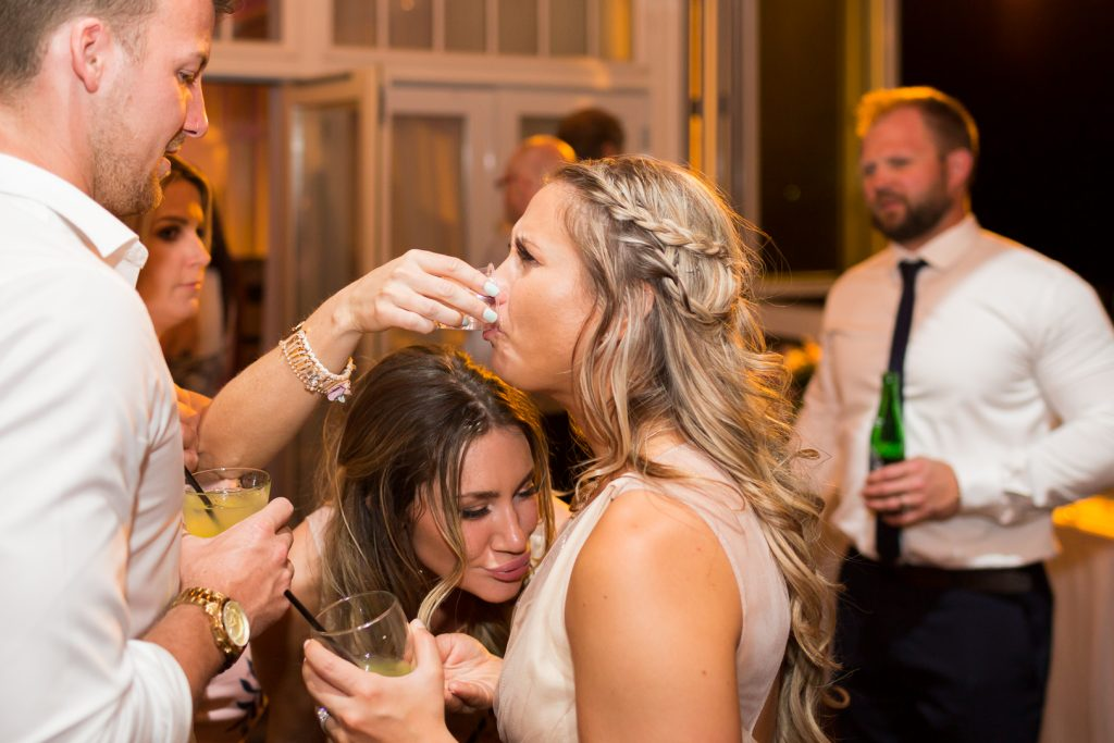 Bridesmaids doing shots