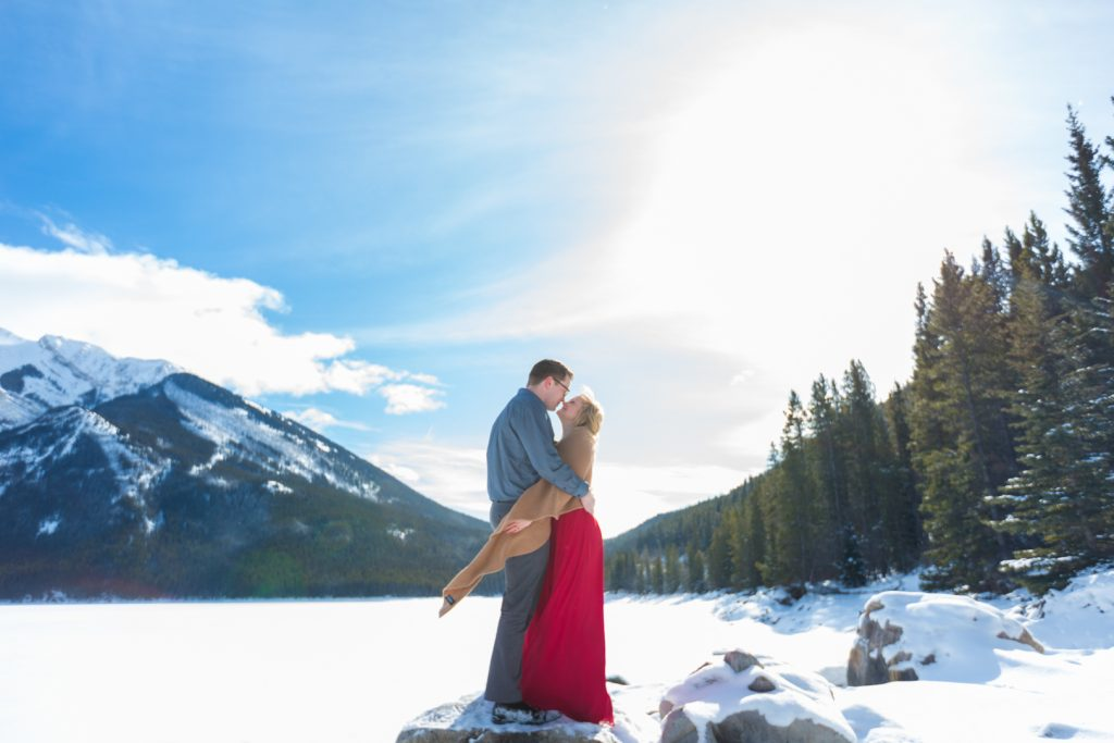 romantic engagement photos at lake minnewanka in banff