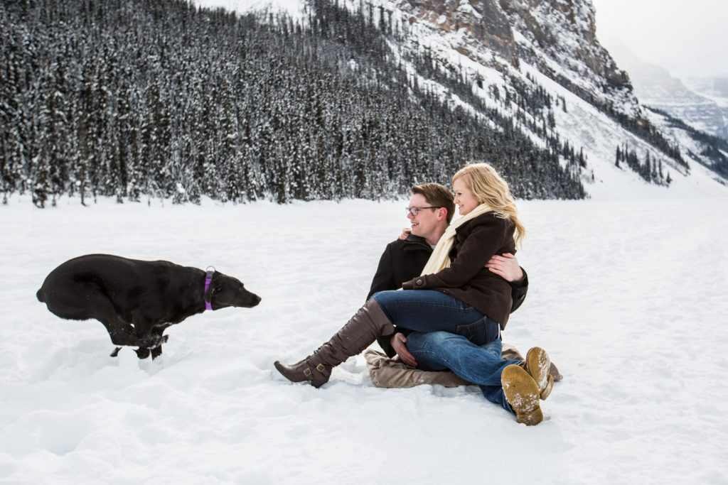 dog running towards owners during engagement session