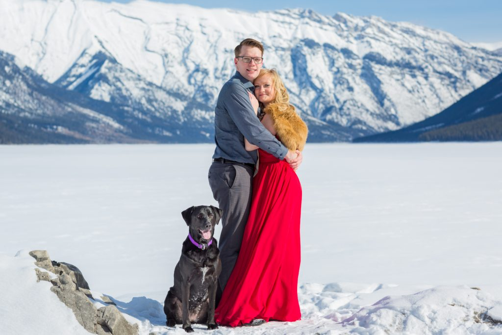 winter engagement photos in banff with dog