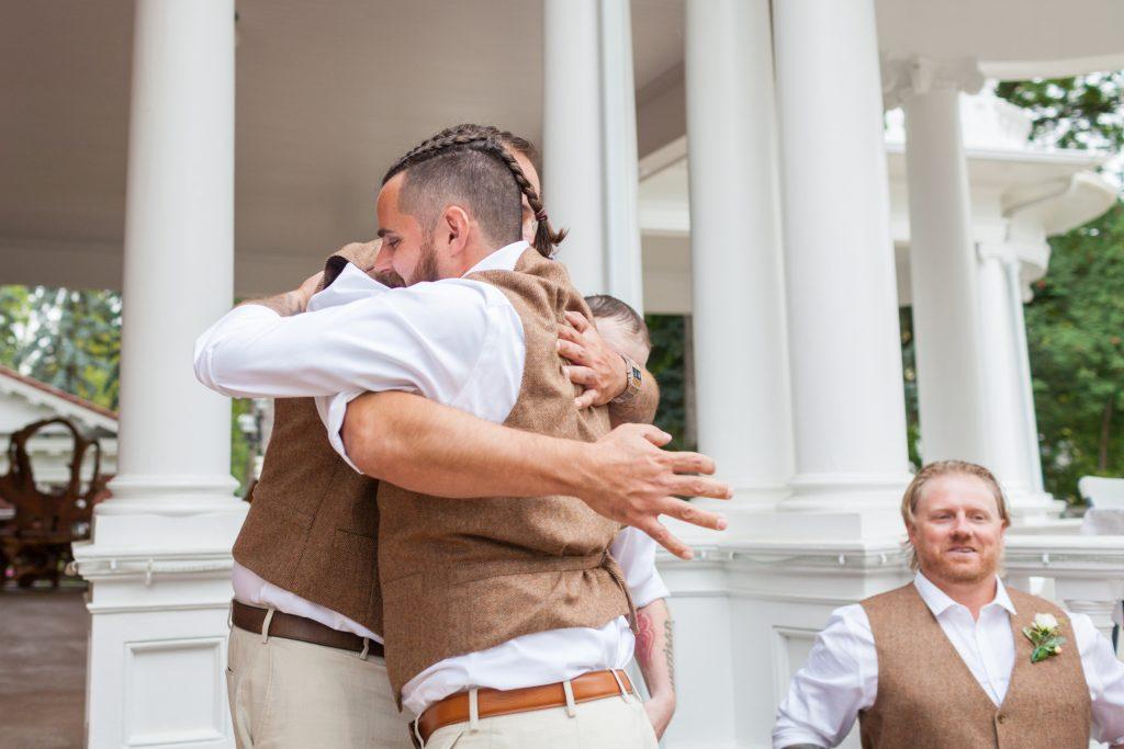Groomsmen walking into wedding