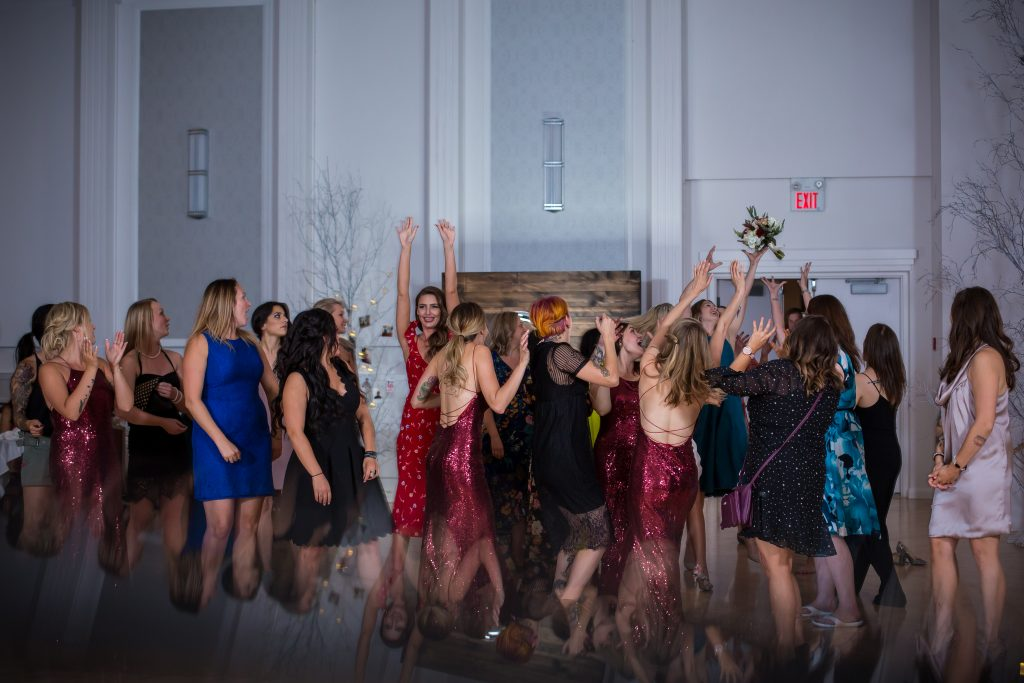 photo of girls going crazy to catch the bouquet
