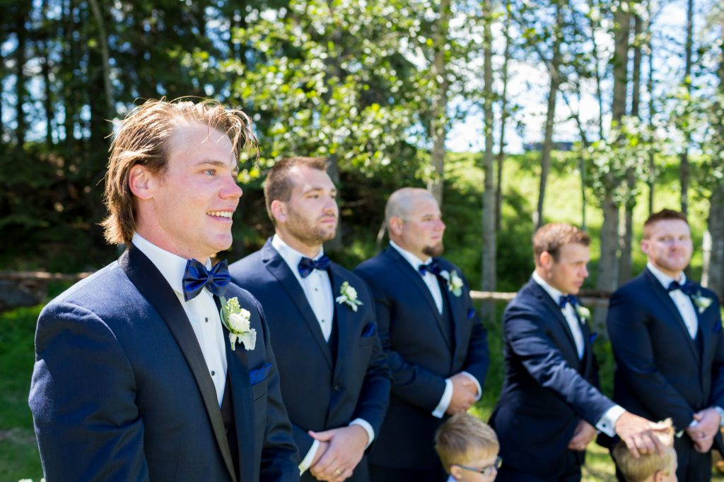 photo of groom seeing the bride for the first time during country wedding ceremony
