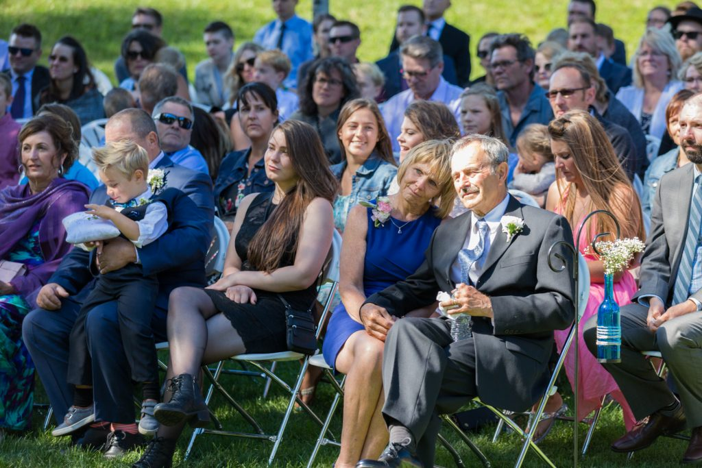 grooms parents watching the wedding ceremony
