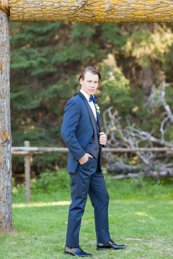 Portrait of the groom wearing three piece suit and bow tie
