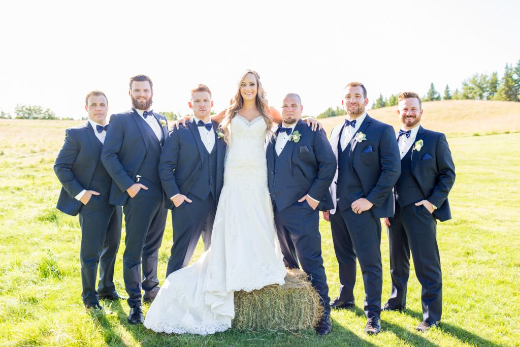 photo of the bride with all of the groomsmen