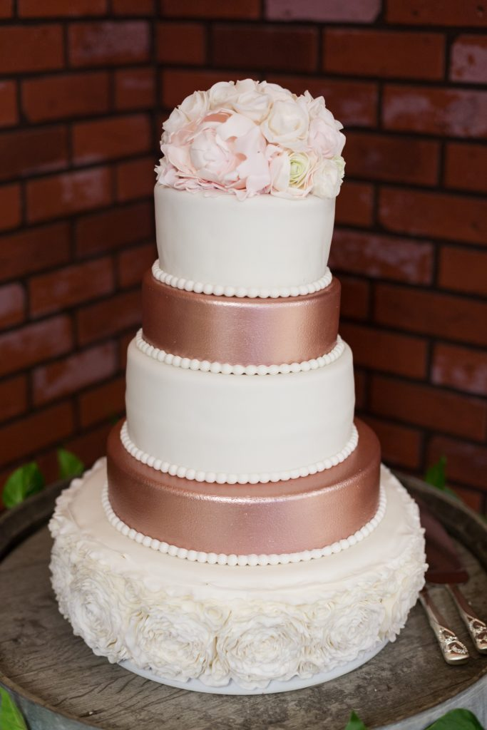 Photo of blush and white wedding cake