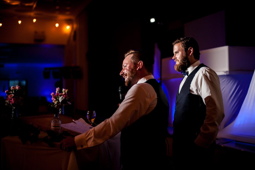 photo of the groomsmen giving their toast to the groom