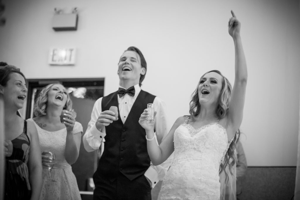 bride and groom getting screeched in during their wedding reception