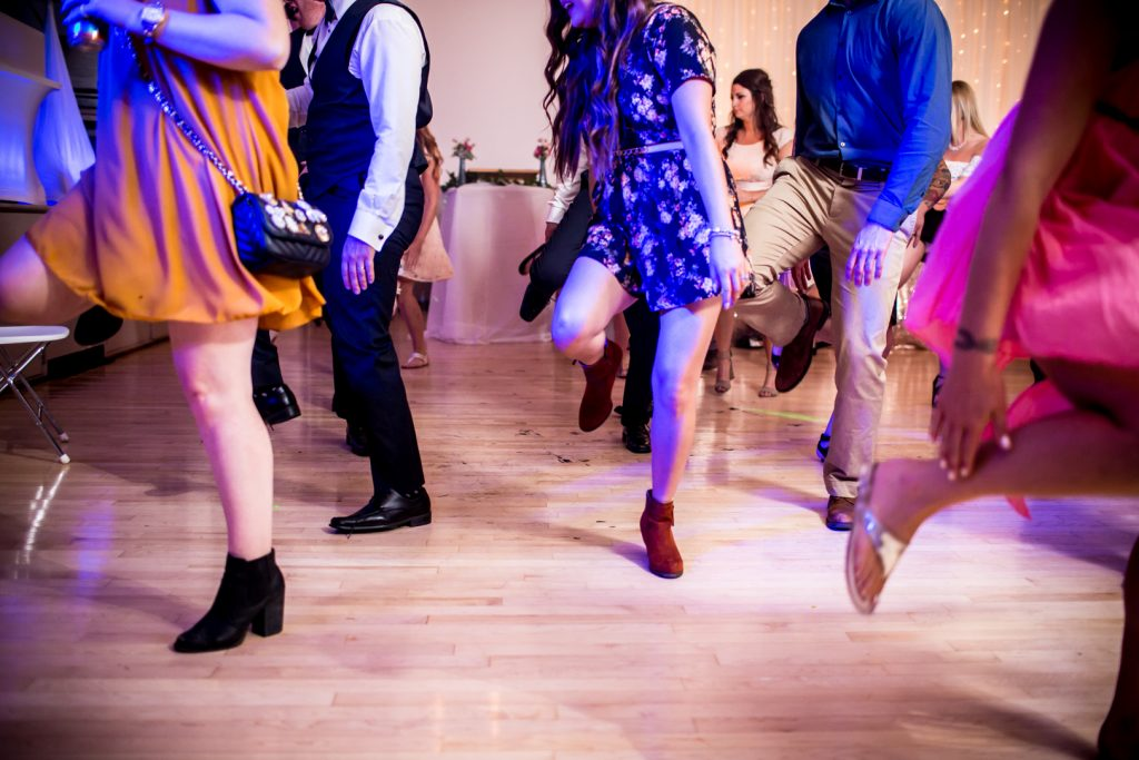 Photo of guests dancing during wedding reception