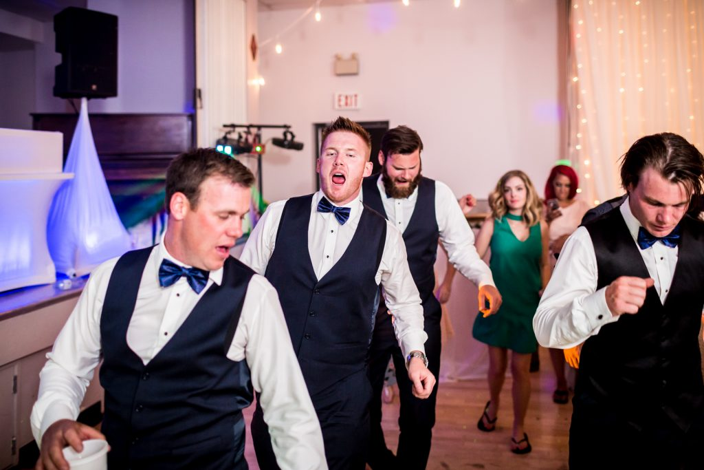 Groomsmen dancing during wedding reception