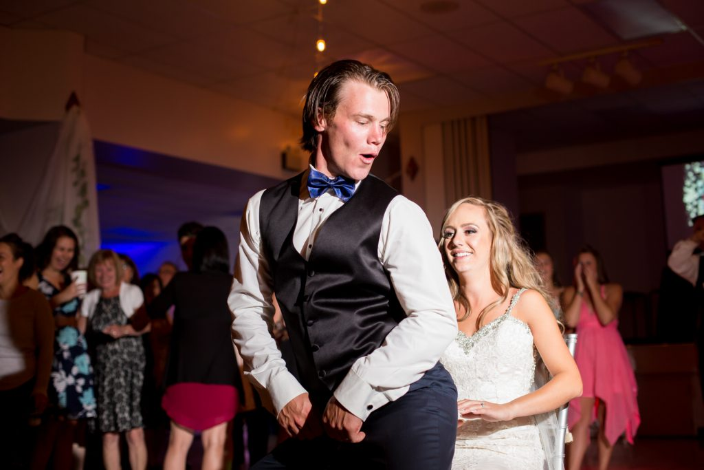 Fun photo of the groom dancing with the bride