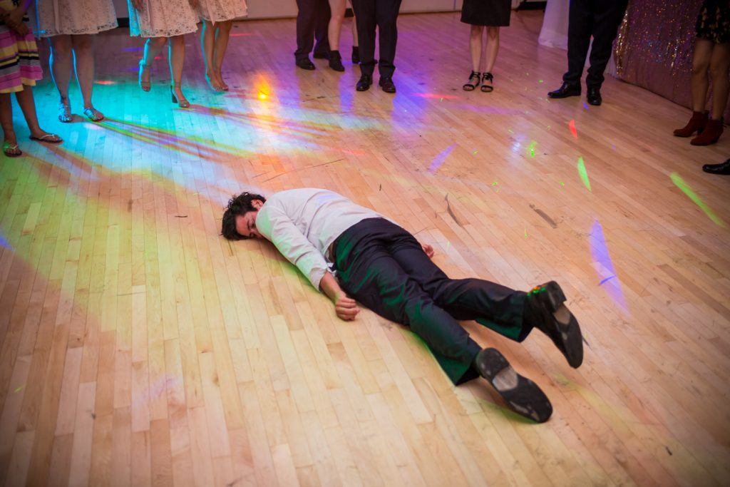 Epic dance party photo of guest lying on the floor