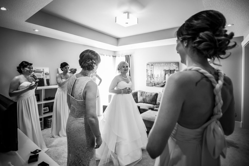 Bridesmaids reaction to seeing the bride in her dress