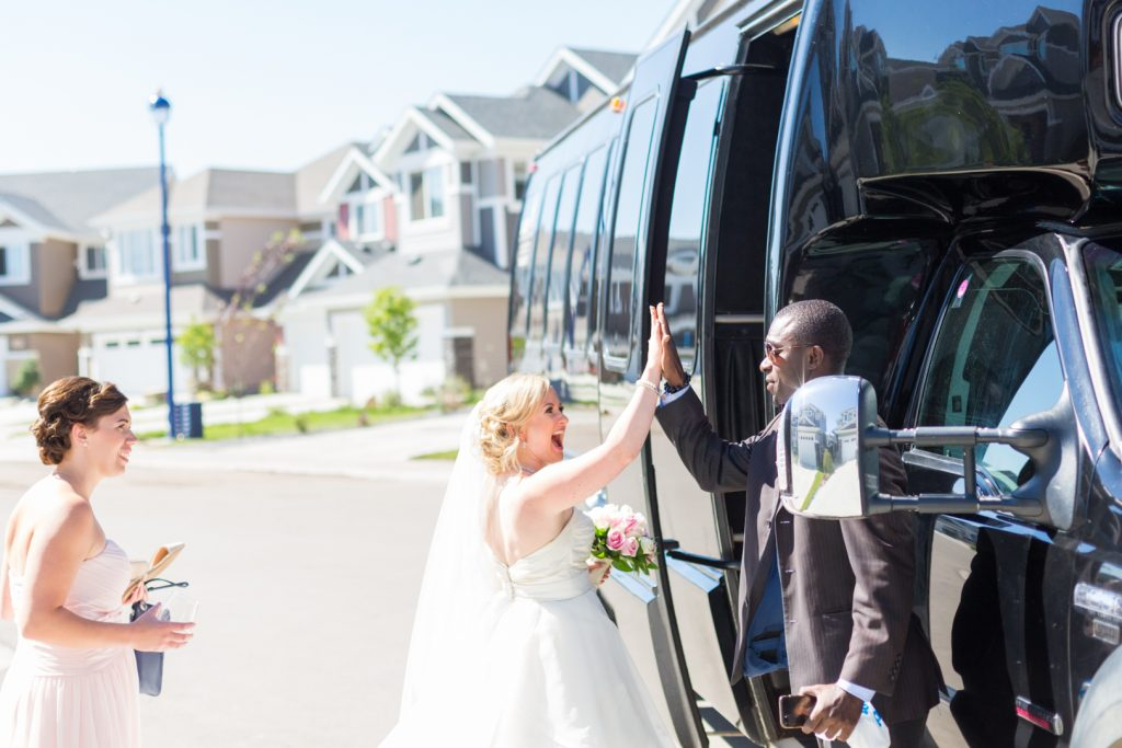 Bride getting into wedding limo