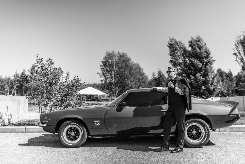 Groom portrait with car