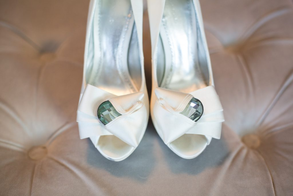 Photo of brides white wedding heels