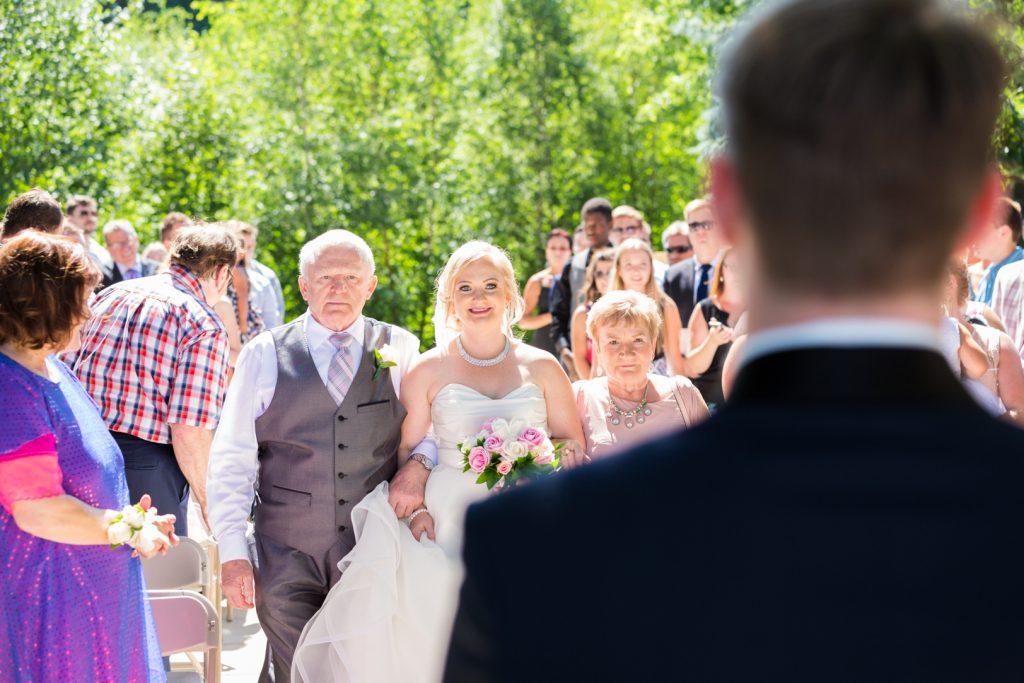 Bride walking up to meet her groom