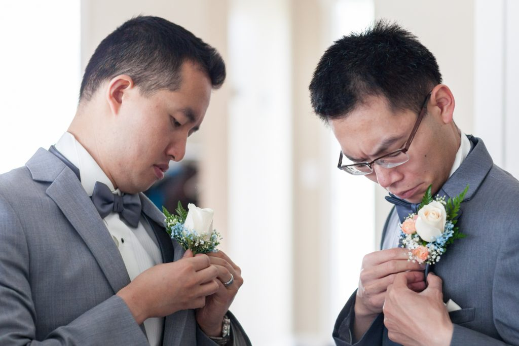 Groomsmen with ivory and blush rose boutonnieres