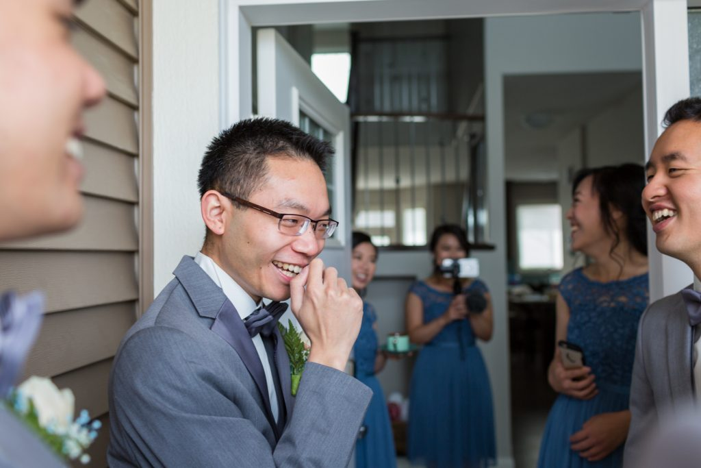 Groom playing games during traditional Chinese wedding