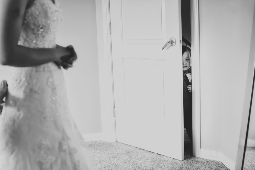 Ring bearer sneaking into the brides room while she is getting ready