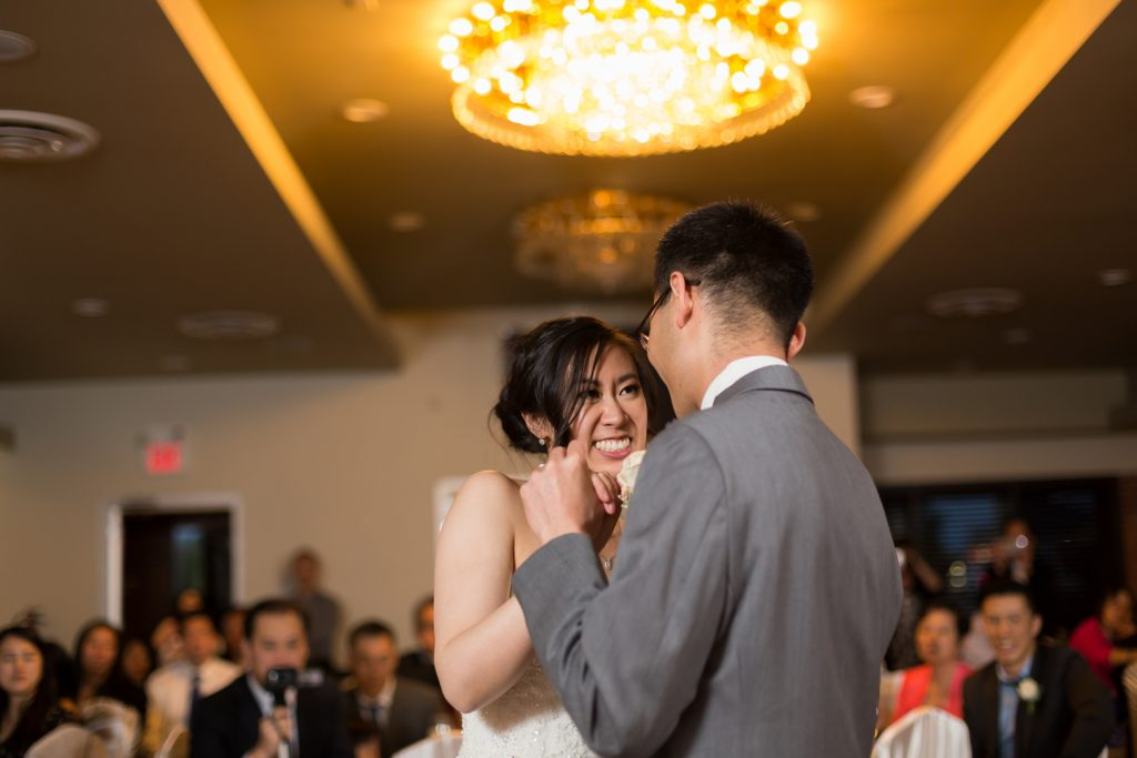 Chinese wedding reception, bride and groom share their first dance