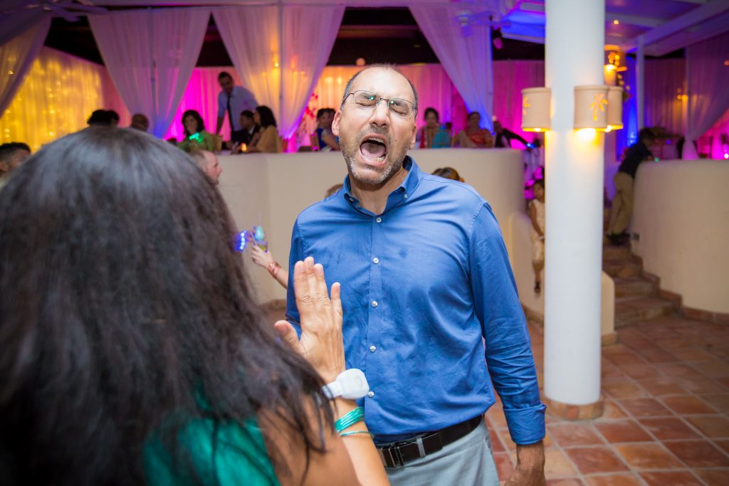 Guests dancing and singing during Antigua destination wedding