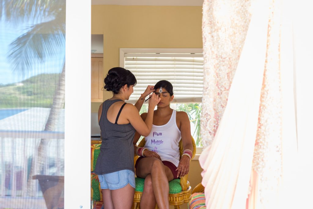 Bride getting her makeup done in her villa before the destination wedding ceremony