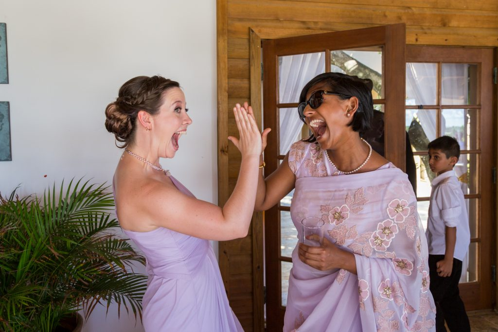 Bridesmaids celebrating following the destination wedding ceremony