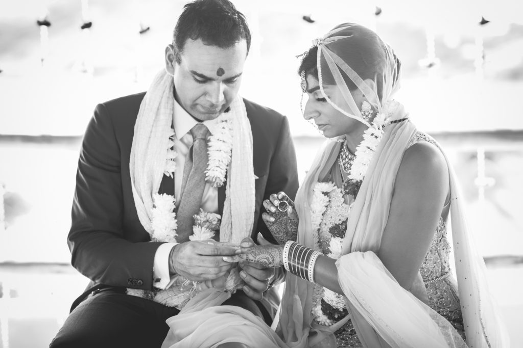 Indian couple keeps the tradition of exchanging rings at the end of their wedding ceremony