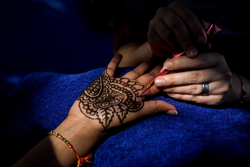 Traditional bridal mendhi being done for the bride during Antigua destination wedding preparations