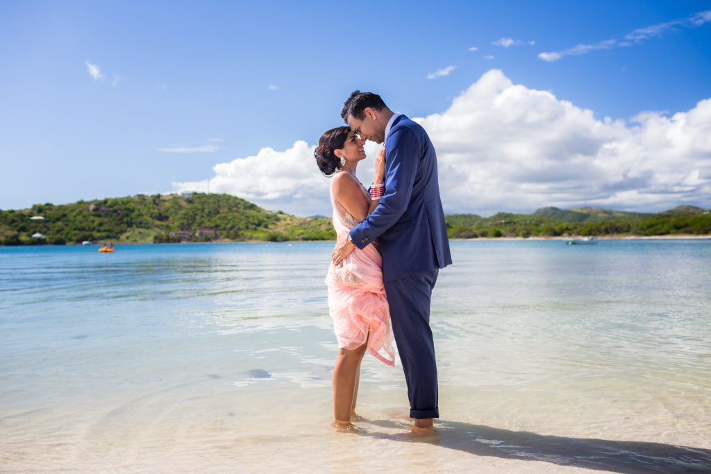 Bride and groom enjoy the warm waters of Antigua on their wedding day