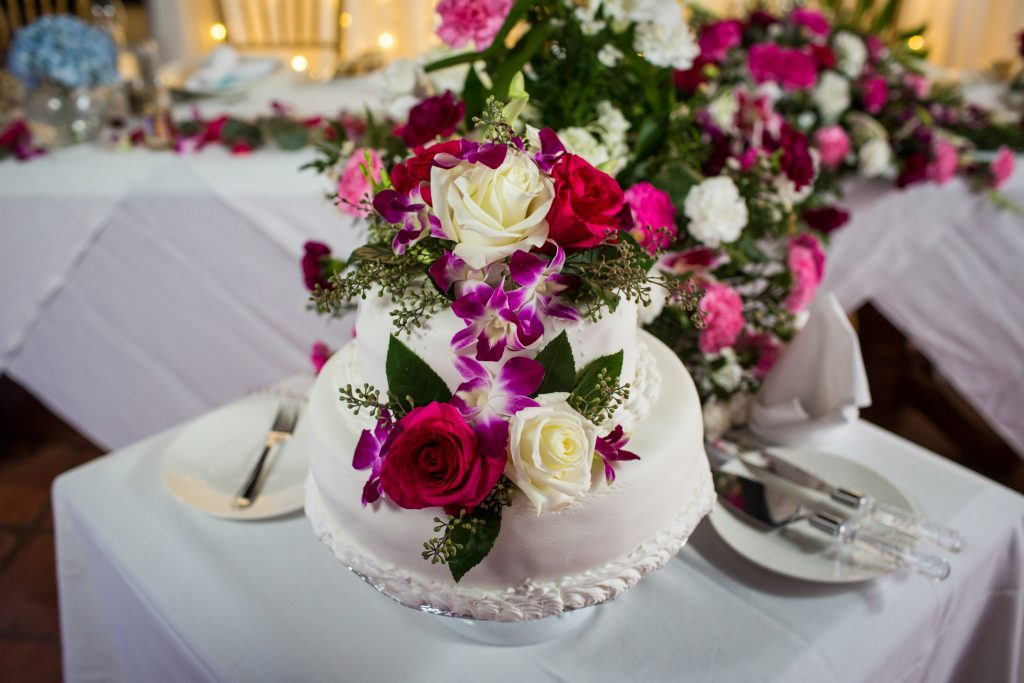 Flower covered wedding cake for Antigua destination wedding