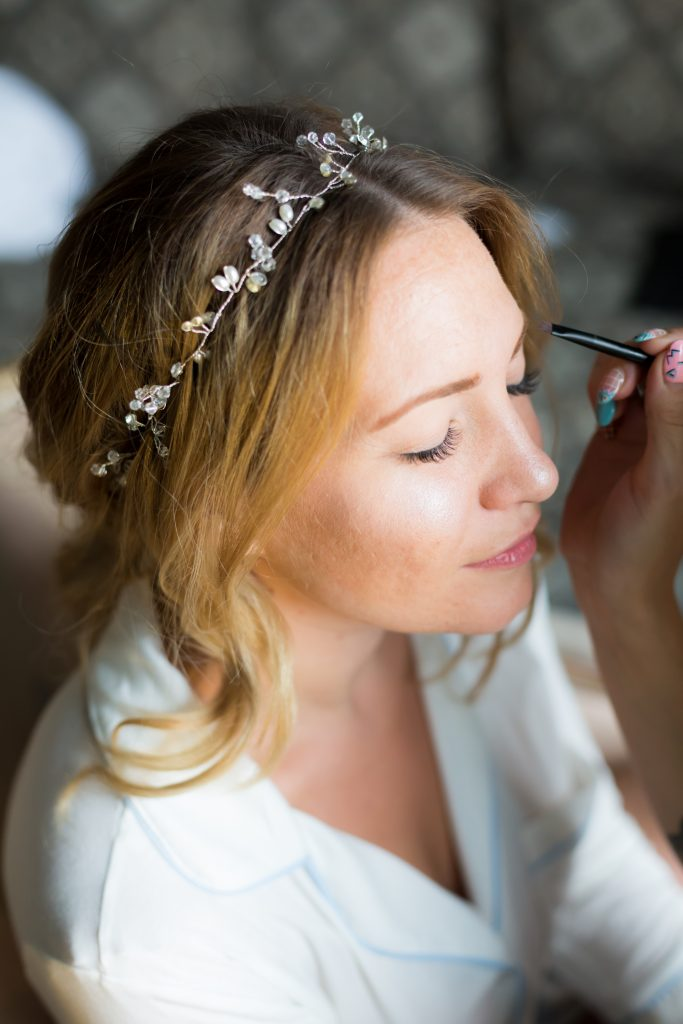 Detail photo of the bride getting her make up done