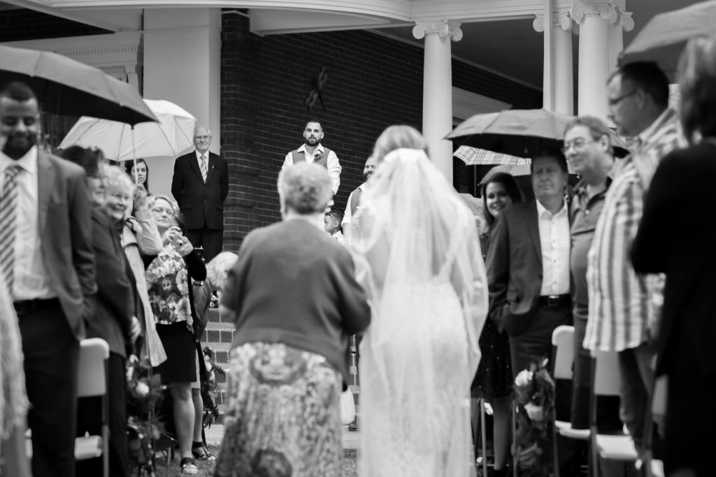 bride walked down the aisle by her grandmother